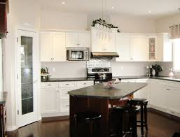 Image Of White U Shaped Kitchen Design With Brown Small Island Seating