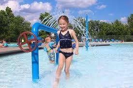 Girl Playing In Fountain Run