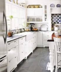 floor tiles with white cabinets