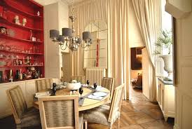 Long Ivory Curtains Bring Dramatic Elegance To The Dining Room While Glossy Red Shelves Add