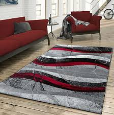 teppich wohnzimmer modern gewellte musterung grau rot