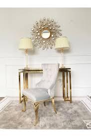 gepolsterter steppstuhl auf stahlbeinen gold grau für das greta wohnzimmer