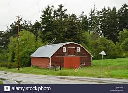 Old Red Barn Building On Whidbey Island, Washington State. Rural ... Red Barn Washington Landscape Pictures Pinterest Barns Original Boeing Airplane Company Building Museum The The Manufacturing Plant Exterior Of A Red Barn In Palouse Farmland Spring Uniontown Ewan Area Usa Stock Photo Royalty And White Fence State Seattle Flight Interior Hip Roof Rural Pasture Land White Fence On Olympic Pensinula