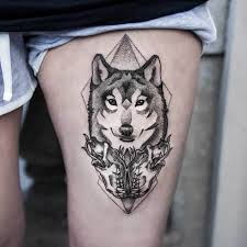 This Tattoo Is Engraved On The Leg It A Wolf Which In Red Colour And Looks Very Furious Gives Scary Vibe