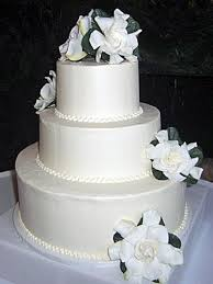 traditional white wedding cake white flowers pearls three round tierss full