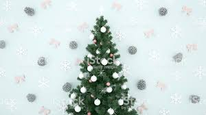 Christmas Tree With Pine Cone Snowflake And Ribbon On Light Blue Background