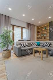 bright living room interior with the carpet ceiling backlight