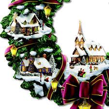Thomas Kinkade Christmas Tree Cottage by The Thomas Kinkade Illuminated Christmas Village Wreath