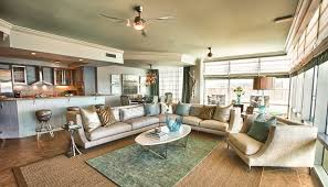 layering rugs living room beach style with roman blinds vented