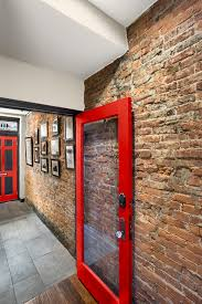 Exquisite Industrial Entry Exposed Red Brick Features Wall Hall With Decor Gallery Collection Of Large Crystal
