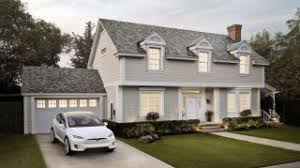 here s how much installing tesla s solar roof will cost you
