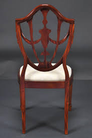 Carved Back Dining Room Chairs. Style Carved Mahogany Wheel Back ... Custom Made Modern Wood Ding Room Chair With Carved Seat Gazelle Crown Mark Kiera 2151sgy Traditional Side With Mahogany Chippendale Chairs For The Leather Seats Antique Round Table Set 21 W Of 2 High Back Linen Blend Hand Solid Frame Classic Arab Wedding Cross Bar Cast Pulaski Fniture San Mateo Pair Teak Fniture In 2019 Sothebys Home Designer Hooker Handcarved Wooden Luxury Palace White Color Baroque Carving For Set Of 82 19th Century Carved Swedish Birch Chippendale Design