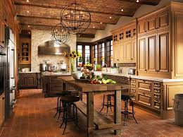 Deep Luxury And Rustic Style Meet In This Vast Kitchen Where Beige Dark Natural Wood Cabinetry Over A Red Brick Floor Both Marble Topped Island