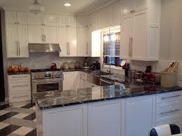 1980s Oak Kitchen With Dark Slate Backsplash Black Counters Updated To 1950s Retro Look White Cabinets Subway Tile And Granite