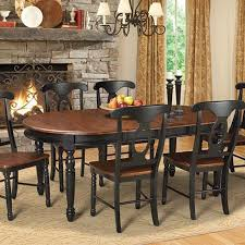 A Chic Complement To Bone China And Gleaming Silverware This Charming Wood Dining Table Showcases