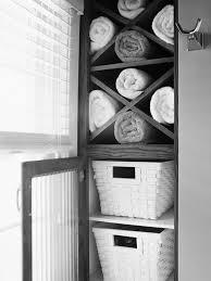 Stunning Three Rattan Towel Storage Basket With Black Iron Stands As Rustic Bathroom