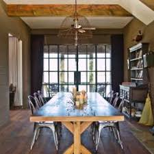 Industrial Farmhouse Dining Room With Wooden Table