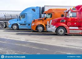 100 Simi Trucks Bright Big Rigs Semi Standing In Row On Truck Stop