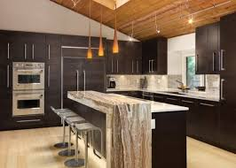 brilliant pendant lighting above kitchen island using colored