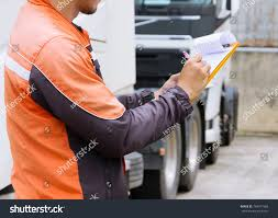 Professional Truck Driver Checks List Truck Stock Photo 784317568 ... Truck Driver Professional Worker Man Royalty Free Vector Stylish Driver And Modern Dark Red Semi Stock Image Professional Truck Checks The Status Of His Steel Horse How To Make Most Money As A Checks List Photo 784317568 Lvo Youtube Appreciation Week 2017 Specialty Freight Courier Resume Format Insssrenterprisesco Cobra Electronics A Big Thank You Our Drivers Our Is She The Sexiest Trucker In The World Driving Jobs Archives Smart Trucking Veteran Wner Dave Conkling