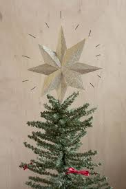 Christmas Tree Toppers Disney by The Thomas Kinkade Revolving Christmas Tree Topper Hammacher Star