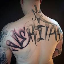 Martinez In Newyork Style Graffiti Tattoo On Upper Back