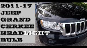 how to change replace headlight bulb in jeep grand 2011