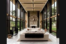 100 Bray Island Twostory Living Room Flanked By Floortoceiling Windows In This