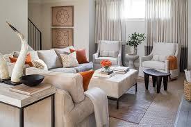 gray and orange living room with pumpkin hermes blanket