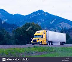 Modern Popular Powerful Yellow Big Rig Semi Truck With A ... A Yellow Box Delivery Truck With Blue Sky Stock Photo Picture And Trucking Industry Skyline Semi City And Large Ltl Company Numbering New Hammond Trucker School To Ppare For 65k Careers Business Centy Pull Back Tata Ace Freight Carrier The More Of These Yellow Signs We See The Safer Sharing Roads Shipping Cnections Nwas Fullservice Brokers Reddaway Joins Blockchain In Alliance Cca Kids Blog Takes Awareness On Road Hd Big Wallpapers Free Wallpaperwiki Modern Truck Stock Photo Image Black Driving 34603532