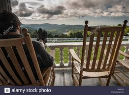Feet Up Relaxing Rocking Chair Front Porch - Amazing View ... Porch Rocking Chair Best Fniture Relaxing All Modern Bestchoiceproducts Choice Products Outdoor Wicker For Patio Deck W Weatherresistant Cushions Green Rakutencom 2 Top 10 Chairs Reviews In 2018 Hervorragend Glider Recliner Glamorous Stork Craft Hoop Ottoman Set Weather Rocker Chair Wikipedia Indoor Traditional Slat Wood Living Room White Dedon Mbrace Summer That Rocks Bloomberg Awesome Of The Harper House 57 Rockers On Front Decorating For Autumn