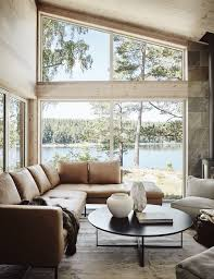a scandinavian lakeside cabin in warm neutral hues lake