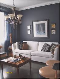 Living Rooms With Dark Navy Blue Walls White Sofa And Classic Chandelier