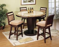 elegant dining room with wooden round brown marble faux top table