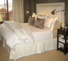 Chic Ivory Taupe Bedroom Design With White Nailhead Trim Headboard Sisal Rug