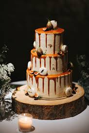 Wedding Cake With Dripping Decor On Tree Slab Stand