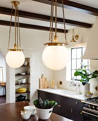 world brass globe pendants and black kitchen cabinets with