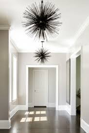 hallway with statement lighting intérieur residential