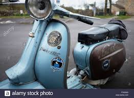 Vintage Innocenti Lambretta 125 Special Scooter In Factory Blue With Stickers And Engine Cover Modification Parked