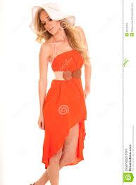 woman orange dress sun hat look down stock photo image 39795812