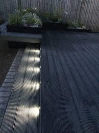 dark grey composite decking sleeper raised beds floating bench