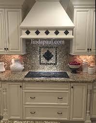metal flower accent tiles for kitchen backsplashes
