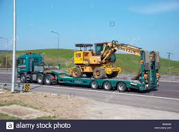 Digger On A Flatbed Lorry Stock Photo: 29077258 - Alamy Hot Wheels Monster Jam Grave Digger Truck Purple Free Shipping Ebay Children Model Pullback Excavator Cstruction Vehicle Trucks Rc Adventures 112 Scale Earth 4200xl 114 8x8 Central Salesford Tandem Texoma 33012 Pssure 32 Wiki Fandom Powered By Wikia Utility Crane Mounted On With Background Ride On Scooter Pul End 11920 728 Pm Kids Helmet Play Activity Grave Digger Truck Trailer Lvo Ls15 Farming Trailer Volvo Eagle355th Bestchoiceproducts 110 Tractor Skid Steer Digital Art Retro Vectors