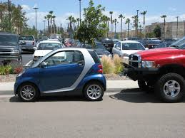 Dodge Ram Meets Smart Car - Dodge Cummins Diesel Forum Smart Car Glorified Truck Battery Youtube 2013 Electric Smtcar Drneon 1999 Fortwo Specs Photos Modification Info At Cardomain Dtown Austin Texas Not A Food But A Food Smart Car Repairs North West Mechanics Lift Kit For Fortwo Forums Memoirs Of Conservative In My Nonvegan High Speed Jet Powered Yes Jet Powered Sew Ez Quilting Vs Our Truck 2017 Smtcar Hydroplane Wreck