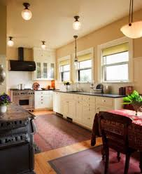 Owner Barbee Lyon Is Attached To The Woodstove That Came With House Floorcloths Enhance