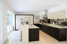 Brilliant Whites Contrast With Black Cabinetry In This Kitchen Raised White Bar Seating Area Attached
