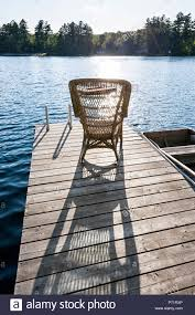 Wicker Rocking Chair On Wooden Dock In Summer At Small Lake ... Amazoncom Tongsh Rocking Horse Plant Rattan Small Handmade Adorable Outdoor Porch Chairs Mainstays Wood Slat Rxyrocking Chair Trojan Best Top Small Rocking Chairs Ideas And Get Free Shipping Chair Made Modern Style Pretty Wooden Lowes Splendid Folding Childs Red Isolated Stock Photo Image Wood Doll Sized Amazing White Fniture Stunning Grey For Miniature Garden Fairy Unfinished Ready To Paint Fits 18 American Girl