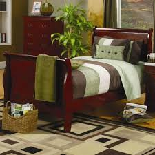 twin size sleigh bed in cherry finish with curved headboard and