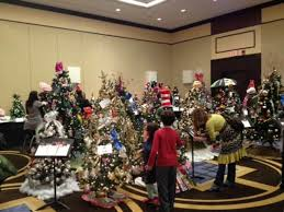 Attendees Of The 2012 Enchanted Forest Fundraiser Admire Christmas Trees