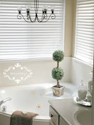 Chandelier Over Bathroom Sink by Be Book Bound From The Design Book A Bathroom Makeover